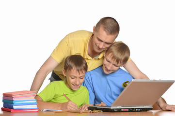 Father is helping kids with homework