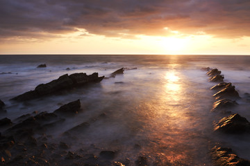 Sunrise with stormy clouds on the rocky coast of Ibaraki, Japan