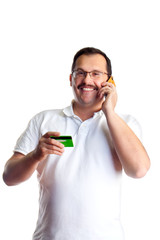 Mature man doing telephone banking