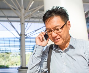 Chinese male adult on the phone