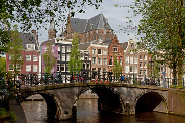 Amsterdam canals with bridge and typical dutch houses