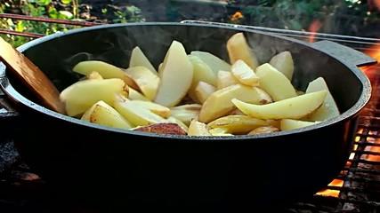 potatoes fried on fire