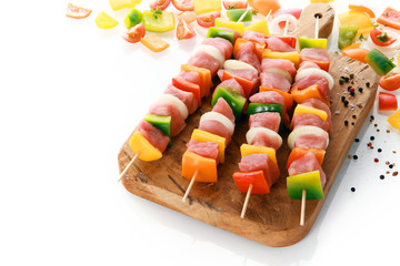 Uncooked meat and vegetable kebabs