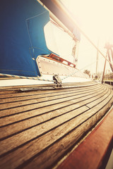 Vintage filtered close up picture of yacht deck and rigging.