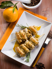 skewer rolled up with clove and orange juice