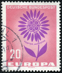 stamp printed in the Germany shows Symbolic Daisy