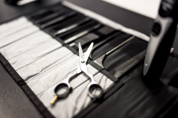 professional haidresser tools on table with close-up of scissors