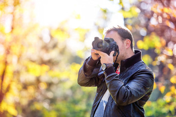 photographer with professional digital camera taking pictures
