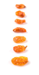 Dried orange colored raisin over white background