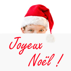 Young boy in red Santa hat and Joyeux Noel