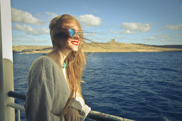 Beautiful girl on vacation on a cruise