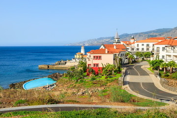Colorful houses in Portuguese village on coast of Madeira island