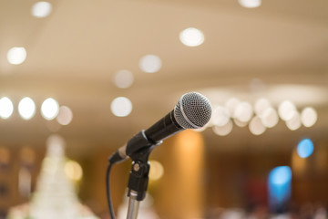 microphone in concert hall or conference room with lights in bac