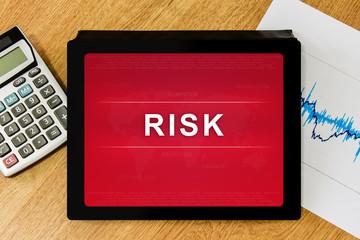 business risk word on digital tablet