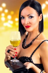 Portrait of attractive woman holding glass of white wine.