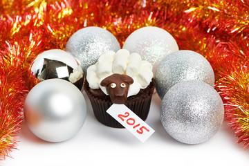 Cake lamb with silver Christmas balls and tinsel as simbol 2015