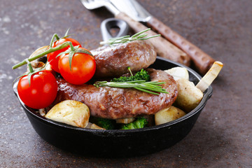 homemade meat sausages with vegetables garnish