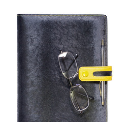 Notebook and glasses on white background with clipping path