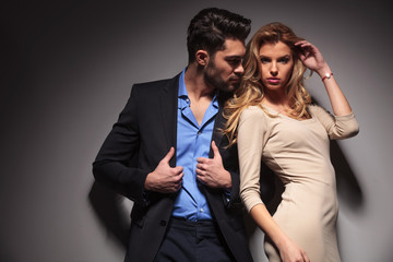 Young fashion couple posing together.