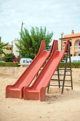 Modern children playground slide in city park.