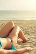 Woman lying on the beach.