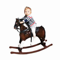one year old boy riding on rocking horse