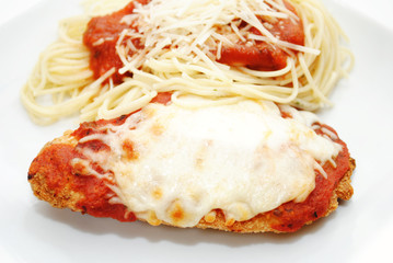 Closeup of Baked Chicken Parmesan with Spaghetti