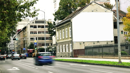 Big poster in the house by the road in the city- Mockup