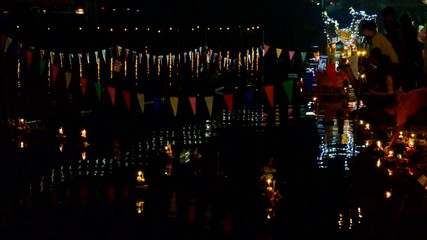 Thai people pray with goddess of water in Loy Kratong Festival