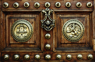 Ancient wooden door, old antique door lock, wooden carving