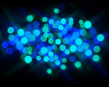 Festive bokeh in shades of blue on black poster