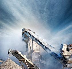 Heavy machinery of gravel production in quarry. Stones breaking