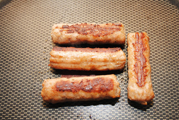 Four Sausage Links in a Fry Pan