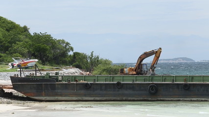 excavators, loading rock to ship