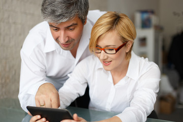 Managers analyzing results on tablet