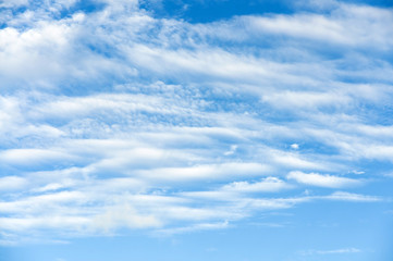 Cirrus and cumulus white clouds on the blue sky