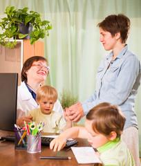 Doctor examining children