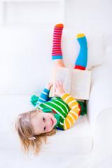 Little funny girl reading