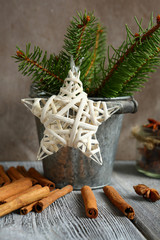 Pine twigs in  small bucket with a star