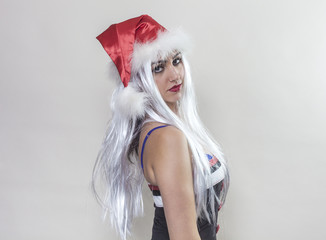 Girl wearing Santa Claus hat and looking