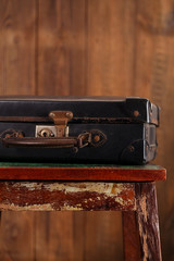 Nostalgic old vintage suitcase on old stool