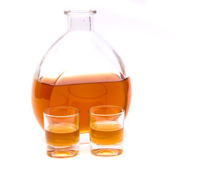 Whisky Bottle with glasses on white background