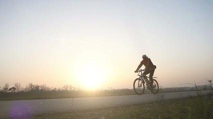 Sunset bike rider