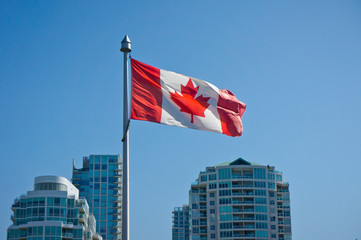 Canadian flag on the Vancouver skyscrapers background