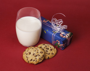 Christmas composition with milk, cookies and a present