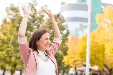Businesswoman celebrating success