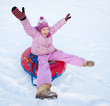 Child sledding in winter hill
