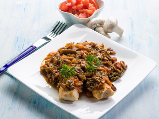 fish with mushroom and tomatoes
