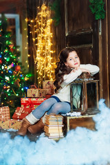 Portrait of the girl near christmas tree