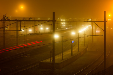 Railway station at a foggy night.